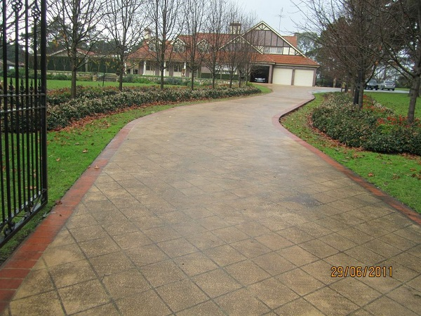 Concrete Driveway Design Ideas splendid front driveway landscaping ideas with white wooden garage door also paver floors After Wizcrete Concrete Resurfacing